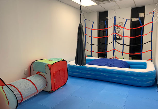 climbing net and crash pad in the pediatric gym
