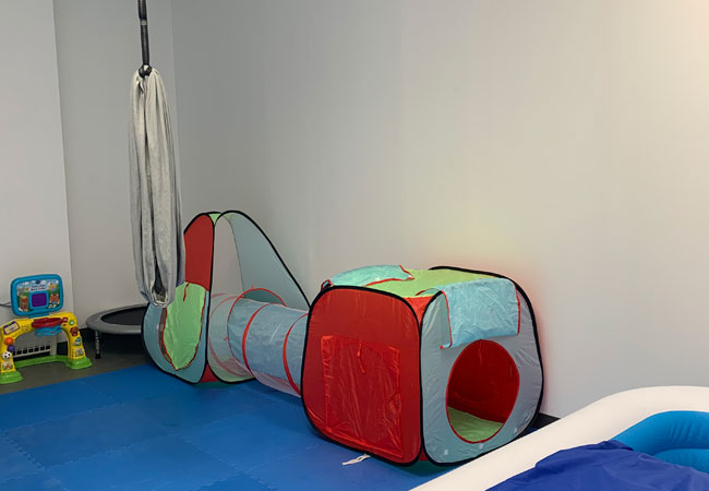 swing and tunnel in pediatric gym